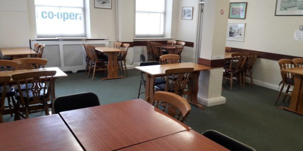 Tables and chairs set up in the Rest Centre in Chudleigh Town Hall