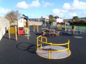 Image of playground at Fore Street showing carousel - Click to open full size image