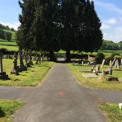 Cemetery with gravestones and trees - Click to open full size image