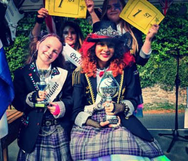 Four young girls holding Silver Cups for winning first place in the Chudleigh Carnival