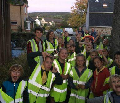 Children wearing reflective jackets