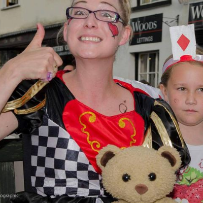 Woman in glasses dressed as the Queen of Hearts