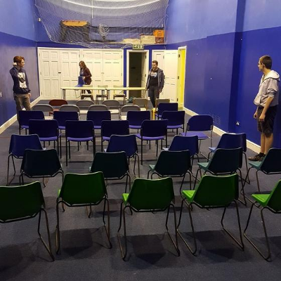 5 rows of chairs set up for a meeting