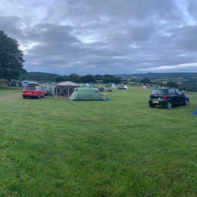 tents spaced out in a large field - Click to open full size image